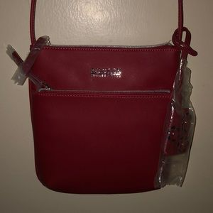 A red Kenneth Cole Reaction Crossbody bag